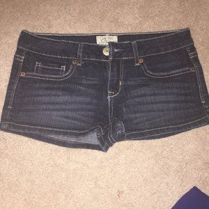 dark wash low rise shorts
